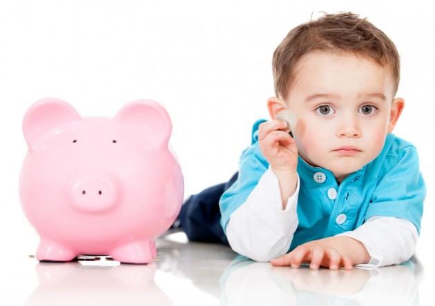 Child and Piggybank