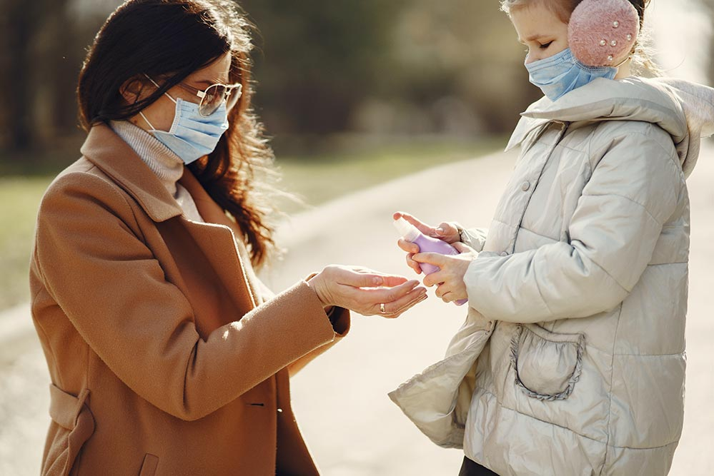 using hand sanitiser